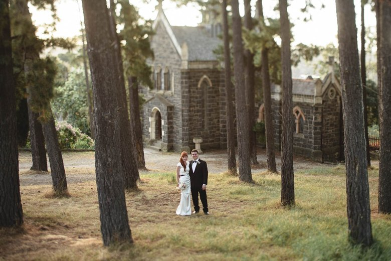 Jane and alex outside the chapel at montsalvat