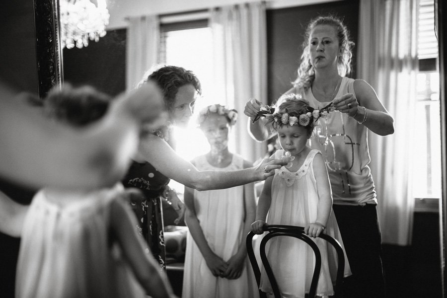 Beautiful flower girls getting dressed for a wedding in the Macedon ranges