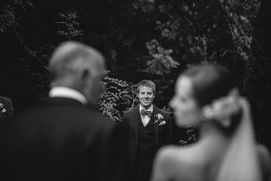 Amazingly happy smile from Josh as he watches Rebecca walk down the aisle