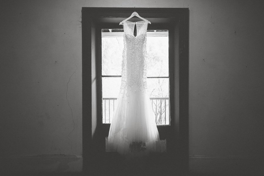 Bridget's wedding dress, hanging from a window at the Collingwood Children's Farm