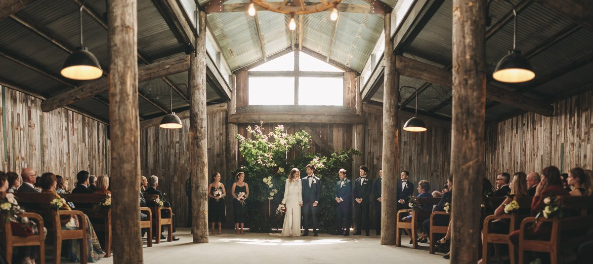A dramatic pano shot inside the barn at James and Clair's Tanglewood Estate Wedding