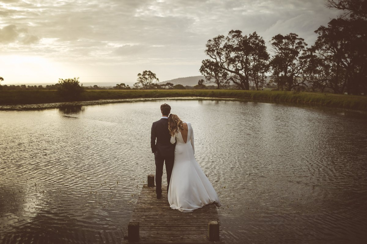 Clair and James just taking a moment out of their wedding by the lake at Tanglewood Estate