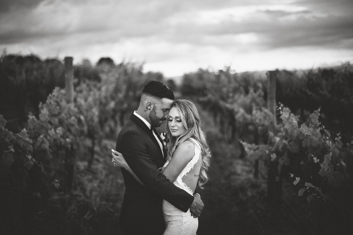 Wedding portrait in the vines at vines of the yarra valley